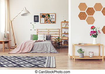 Modern nature-inspired home decor with white walls, posters,...