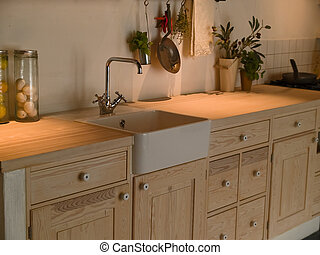 Details of a modern neo classical design decorated wooden country style kitchen