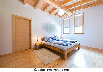 modern new bedroom in warm wooden timber house