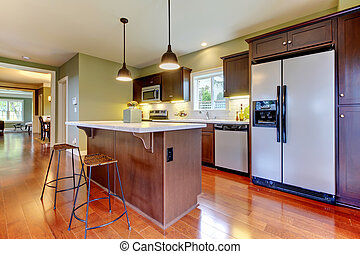 Modern new brown kitchen with cherry floor.