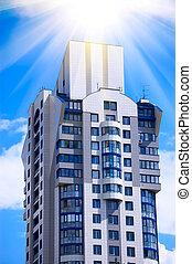 Modern office building on blue sky background