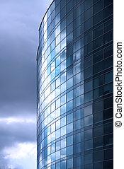 Modern office building exterior. Cloudy. Blue tint.