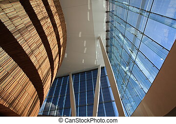 modern office building interiorl with wood wall and glass panels