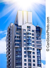 Modern office building on blue sky background