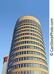 modern office building over sky