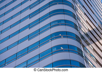 modern office building with blue glass facade