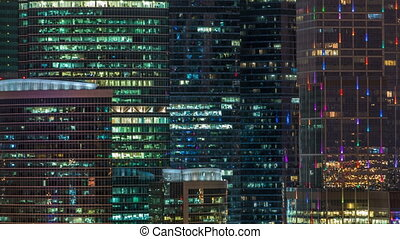Modern office building with glowing windows at night timelapse. Moscow city