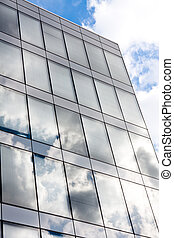 Modern office building with reflection of the sky