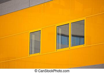 Modern office buildings. Colorful buildings in a industrial place. Orange windows.