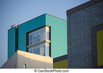 Modern office buildings. Colorful buildings in a industrial place whit sky blue.