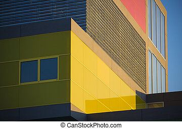 Modern office buildings whit red and yellow windows. Colorful buildings in a industrial place whit sky blue.