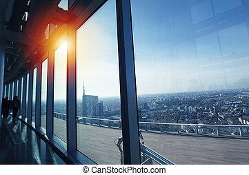 Modern office in a skyscraper during sundown