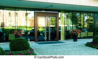 Modern office or residential building entrance reflecting...