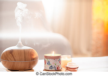 Modern oil aroma diffuser in the living room on the table .