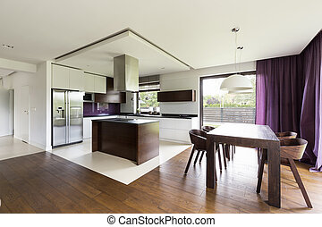 Modern open kitchen with wooden table
