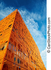 Modern orange building - Wide angle view of an orange front ...
