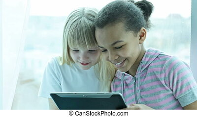 Modern pastime - Modern preteen girls watching interesting...