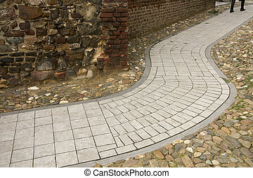 modern pathway in ancient surroundings - A modern grey path ...