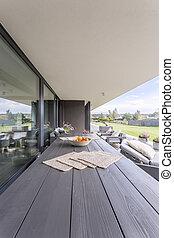 Modern patio with garden table