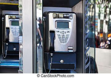 modern payphone on a city street