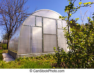 Modern Polycarbonate Greenhouse in Allotments for Growing...