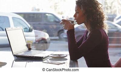 Modern pretty woman having breakfast or lunch