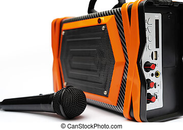 Modern radio, orange, black, with a black microphone