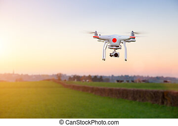 Modern RC UAV Drone / Quadcopter with camera flying on a ...