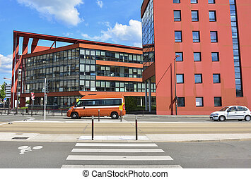 Modern red building with glass windows Sky background