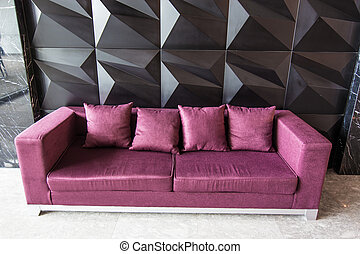 Modern red sofa in front of the wall