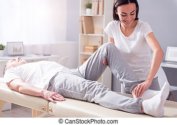 Modern rehabilitation physiotherapy - Exercise. Cheerful...