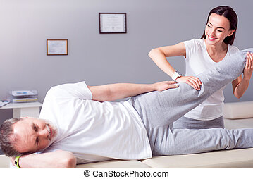 Modern rehabilitation physiotherapy - Healing. Cheerful male...