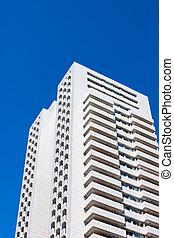 modern residential building on blue sky