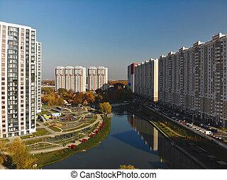 Modern residential buildings near pond Levoberezhny in ...
