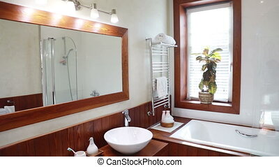 Modern Residential Home Bathroom with large mirror and ...