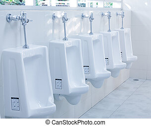modern restroom interior with urinal row - modern restroom...