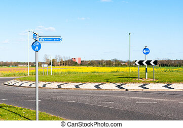 Modern road and roundabout and direction to Business Parks...