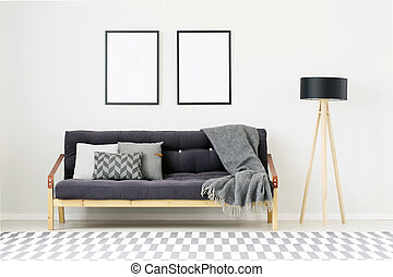 Modern room with empty posters