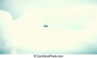 Modern Russian fighter performing landing descent. Slow motion shot