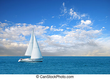 modern sail boat with blue sky and clouds