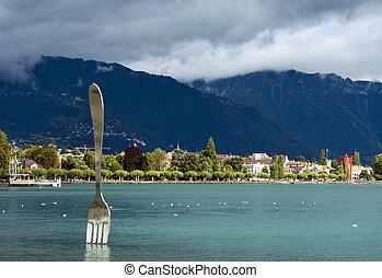 modern art , big fork in water of Geneva lake. Vevey, Switzerland