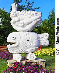 PAVLODAR - Kazakhstan, SEPTEMBER 19, 2010: Modern sculpture of mermaid in park on Toraygyrova str.