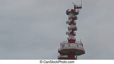 Modern sea radio tower Close-up on the background of the cloudy autumn sky