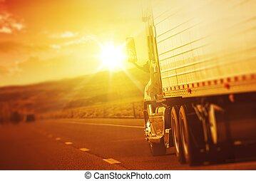 Modern Semi Truck in Motion. American Highway Trucking....