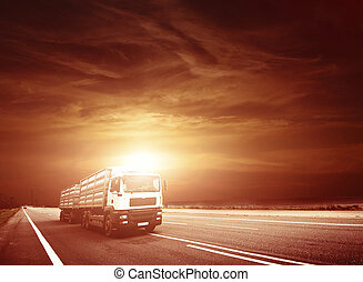 Modern Semi Truck in Motion. American Highway Trucking