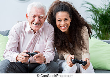Modern senior playing on console
