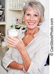 Modern senior woman in her kitchen