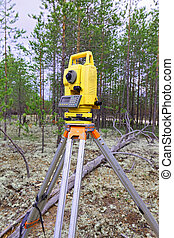 Modern shabby electronic total station mounted on tripod -...