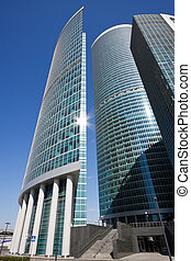 Modern shiny office building in a bright sunny day