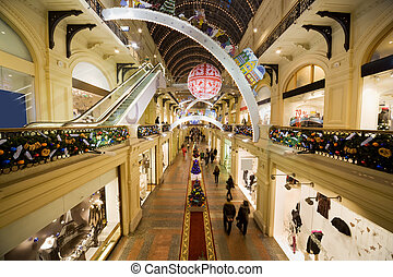 modern shopping center interior at night. Big floor spaces, ...